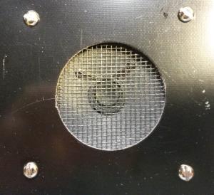 Speaker mounted on PCB under window screen.