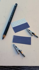 Graphite covered index card pieces, ready for parallel hookup